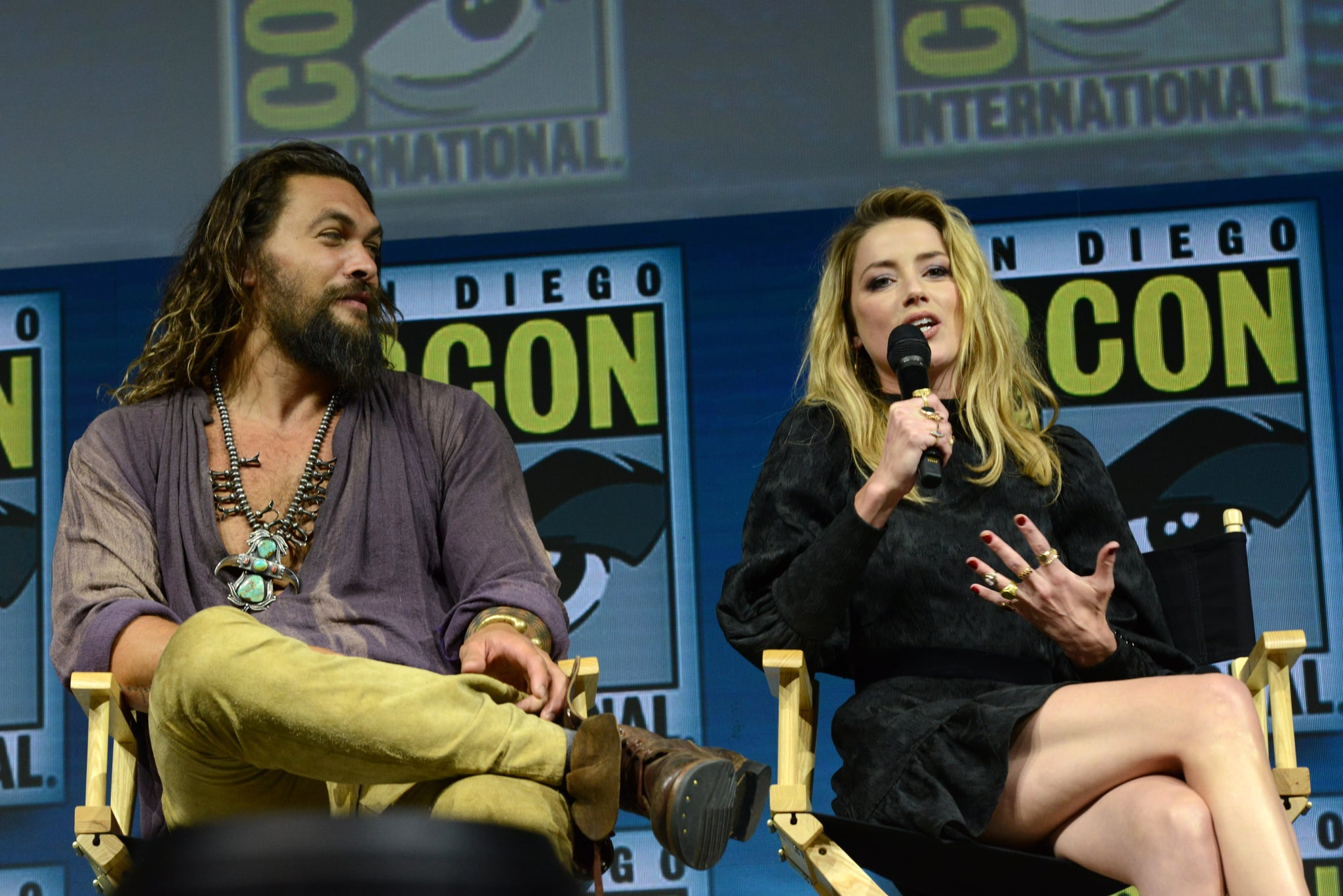 SAN DIEGO, CA - JULY 21:  Jason Momoa and Amber Heard speak onstage at the Warner Bros. 'Aquaman' theatrical panel during Comic-Con International 2018 at San Diego Convention Center on July 21, 2018 in San Diego, California.  (Photo by Albert L. Ortega/Getty Images)