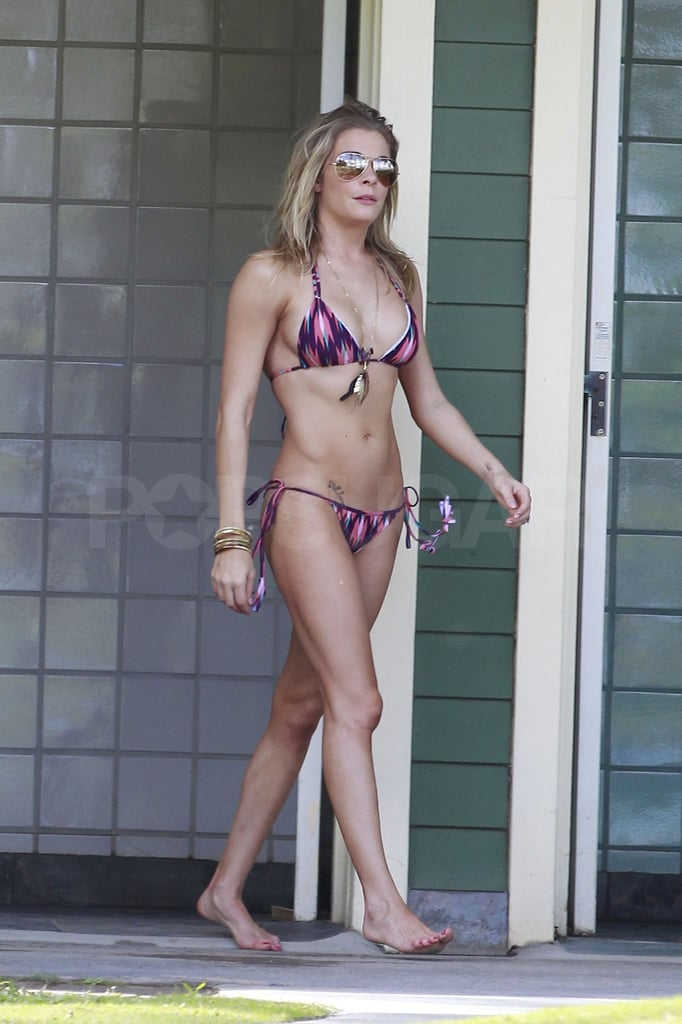 """Bikini-clad LeAnn Rimes was back in the sun yesterday on the island of Maui. She joined her husband, Eddie Cibrian, and friends for an al fresco lunch and some beach time. The couple arrived in Hawaii on Wednesday with plans to relax and kick back before her scheduled performance in conjunction with this weekend's PGA tournament. LeAnn may be showing off her body on the sand, but she's not ready to take it all off for Playboy. LeAnn turned down the opportunity to pose for the publication, saying, """"Mom would kill me, but flattering."""""""