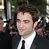 Robert Pattinson flashed a smile at the On the Road premiere at the Cannes Film Festival.