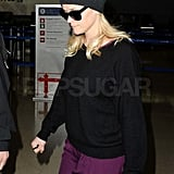Reese Witherspoon in a purple dress at LAX.