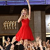 """Taylor took her """"You Belong With Me"""" performance outside and put on a show in front of NYC's Radio City Music Hall in 2009."""