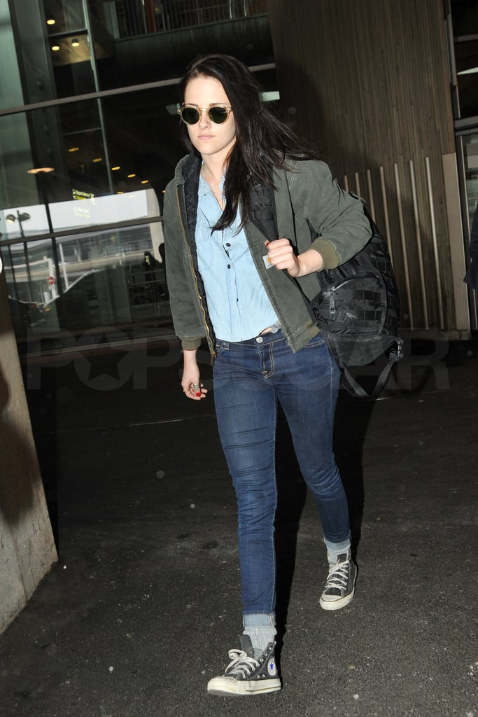 Kristen Stewart made her way through the security line at LAX yesterday. She was wearing her usual sneakers and jeans, but spiced up the look with sunglasses and a denim shirt. Kristen spent the weekend with boyfriend Robert Pattinson in LA, where she celebrated the Oscars at the WME agency party and also dined out at Il Covo with a group of pals. Kristen kicked off the fun few days on Thursday when she went to Balenciaga with her publicist, though we have yet to see her step out in the dress she picked up during the shopping trip. This morning, Kristen arrived in Paris. She's in France just as Paris Fashion Week begins there. Kristen, the new face of Balenciaga perfume, may decide to make a cameo at the brand's Fall 2012 show tomorrow.