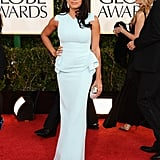 Rosario Dawson posed solo in a baby blue peplum gown.