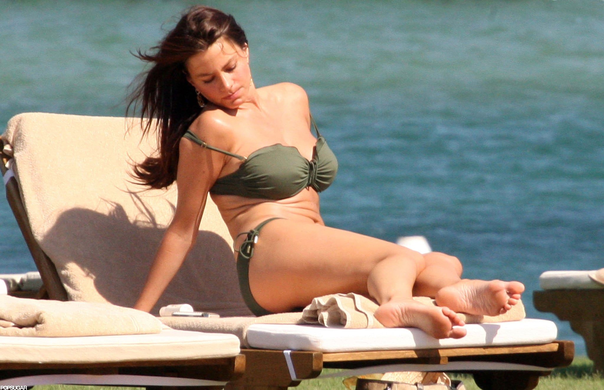 She soaked up the sun in a suit in Italy in July 2010.