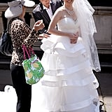 Billy Tsang of Hong Kong adjusts the wedding dress on his wife Miko outside Victoria's State Parliament after they were married in Melbourne.