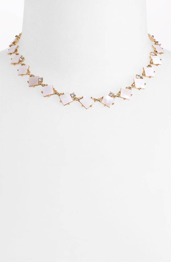 This subtle statement piece would pair well with almost any gown — and do so without upstaging the drama of the dress.  Kate Spade New York Pearl Cove Collar Necklace ($148)