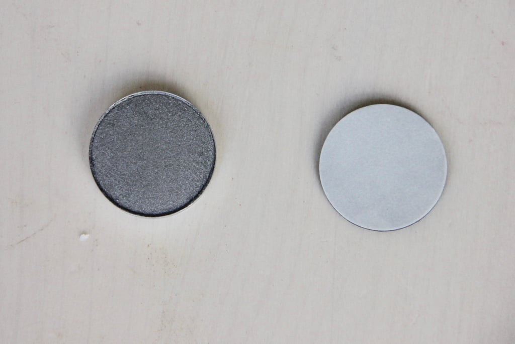 Peel the paper off of the adhesive magnet and stick it to the back of the eye shadow pan. This will allow you to use it in a magnetic palette.