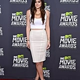 Rocking a crop top and a pencil skirt at the 2013 MTV Movie Awards.
