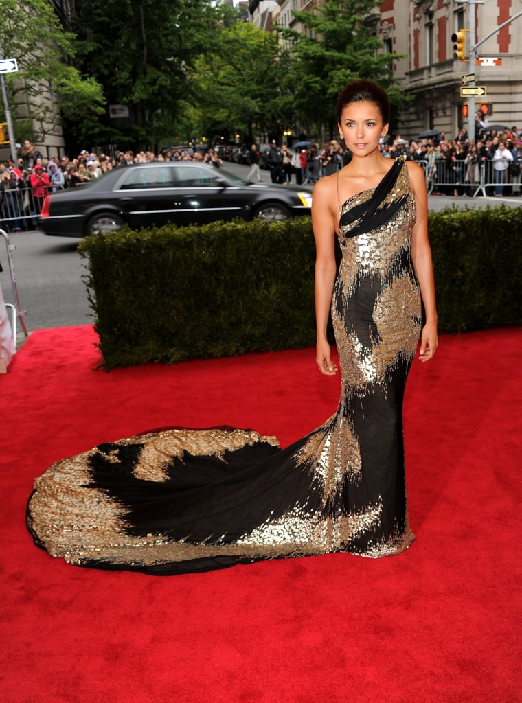 She attended the 2012 Met Gala in an eye-catching liquid black-and-gold Donna Karan Atelier gown — just look at that train!