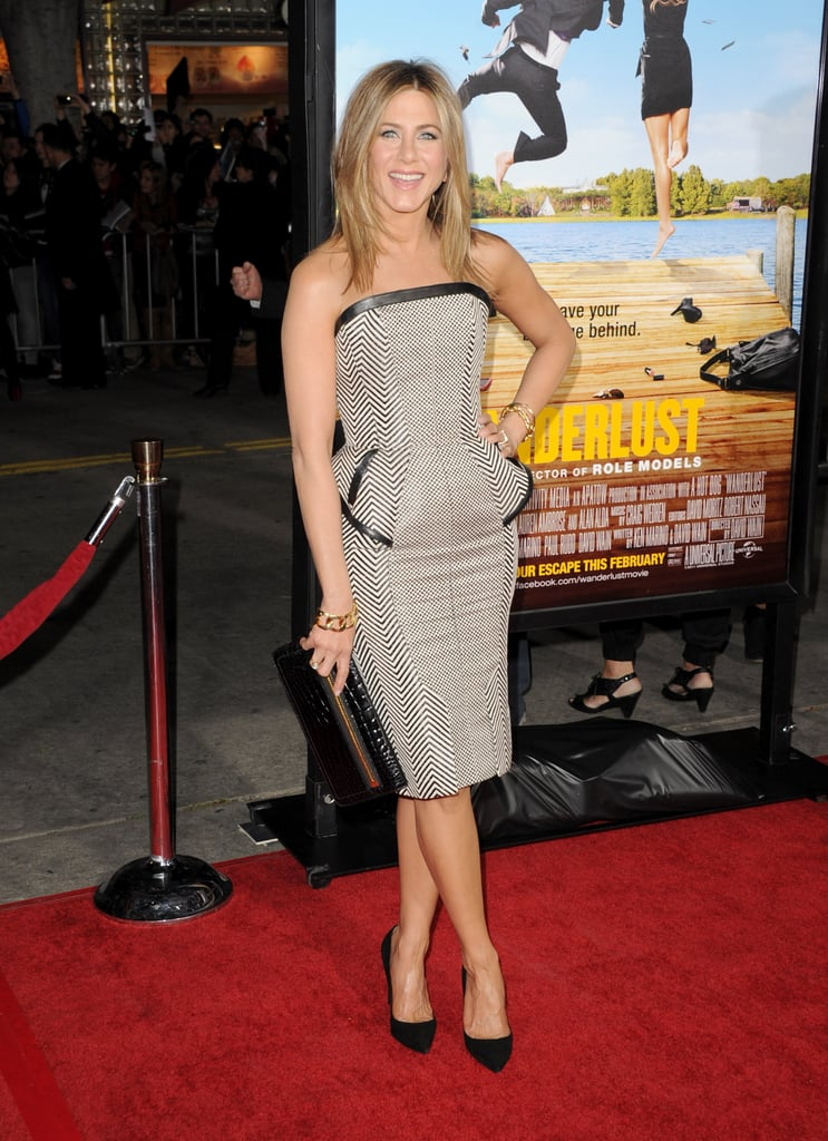 "Jennifer Aniston and her boyfriend Justin Theroux were both in attendance at their LA premiere of Wanderlust at Mann's Theatre on Thursday evening, though she decided to pose solo to kick things off. Jennifer, who celebrated her 43rd birthday with a private party at the Chateau Marmont last weekend, mixed up her standard little black dress habit with this sexy strapless black and white Tom Ford number. Justin was looking sharp in his suit, but he skipped most of the arrivals line and let Jennifer have the spotlight. Instead, Jennifer was focused on her leading man in the film, Paul Rudd. Aniston showed off her abs in a bra for a sexy GQ cover shoot with Paul, while Justin spoke about their actual romantic relationship calling it ""happy"" in an interview.  Wanderlust hits theaters on Feb 24, so we should be seeing a lot more of Jennifer, Paul, and Justin over the next week. Jennifer, for one, will also be honored with a star on the Hollywood Walk of Fame with a big ceremony next Tuesday."