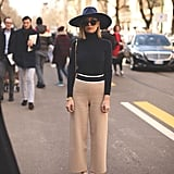 A Black Turtleneck, Khaki Wide-Leg Pants, Heels, and a Wide-Brim Hat