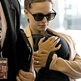 Natalie Portman protected baby Aleph in a carrier in the airport in Paris.