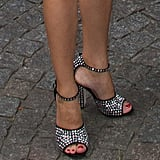 Her high-impact Giuseppe Zanotti heels finished the look with a little oomph — as did her red pedicure.