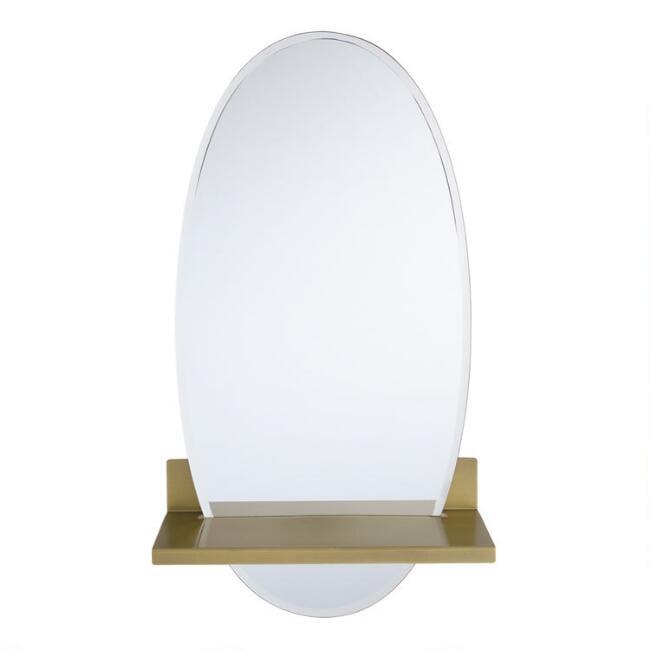 Oval Floating Mirror With Brass Shelf