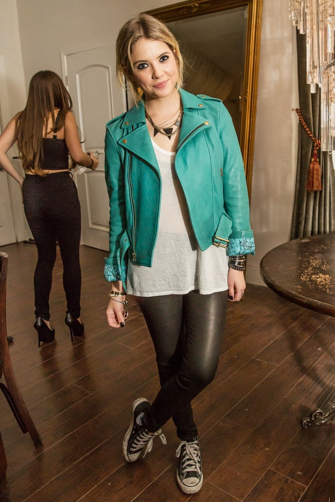Ashley Benson's green leather biker jacket is a great pick for the edgy girl who wants to participate in the festivities. Keep the tough theme going with leather leggings, a pyramid necklace, and Converse sneakers.