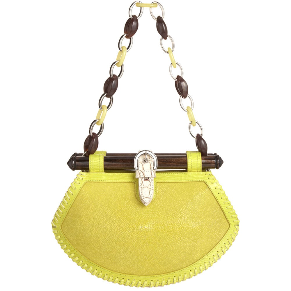Everyone needs a statement clutch this season. This bright yellow stingray clutch from Proenza Schouler comes with a detachable chain-link strap and cool buckle detailing.  Proenza Schouler Tiki Clutch Stingray ($2,170)