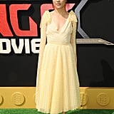 Wearing a beautiful pale yellow midi dress with gold heels at the premiere of The LEGO Ninjago Movie.