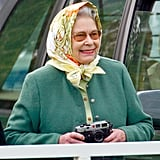 Queen Elizabeth II takes photos of Prince Philip in 2002.