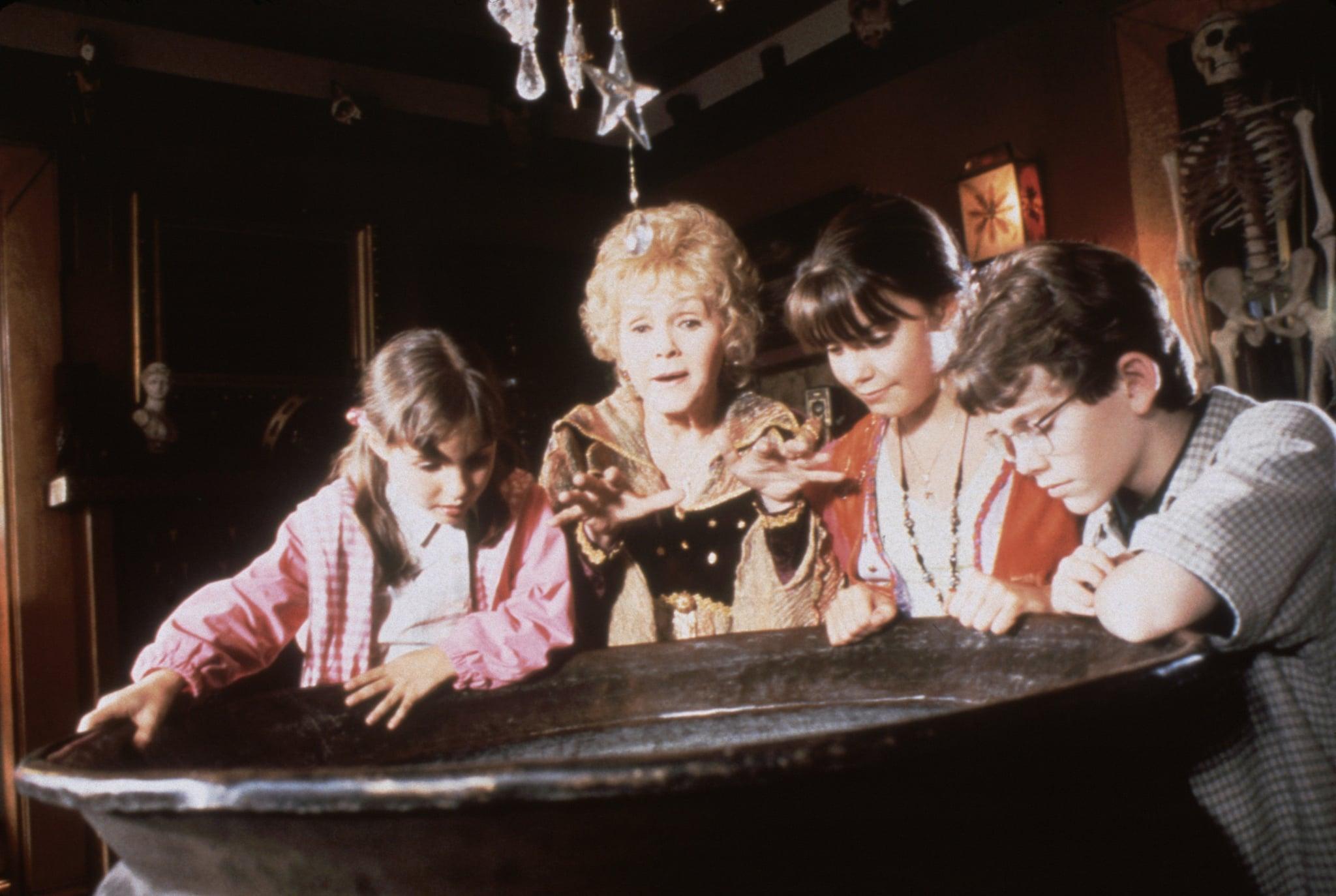 HALLOWEENTOWN, (from left): Emily Roeske, Debbie Reynolds, Kimberly J. Brown, Joey Zimmerman, 1998.  Disney Channel  / Courtesy: Everett Collection