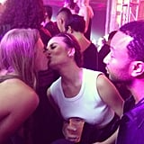 Chrissy Teigen shared a kiss with fellow model Julie Henderson while her fiancé, John Legend, looked on. Source: Instagram user chrissyteigen