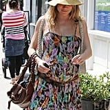 Sienna Miller hid a smile under a floppy hat while walking through London.