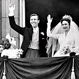 The newlyweds wave to the thousands of people gathered below.