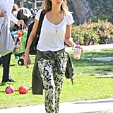 Jessica Alba in Printed Wayf Crepe Pants and Metallic Converse
