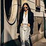 Wear thick snakeskin pants with a lightweight blouse, and throw a heavier fringed jacket on top.