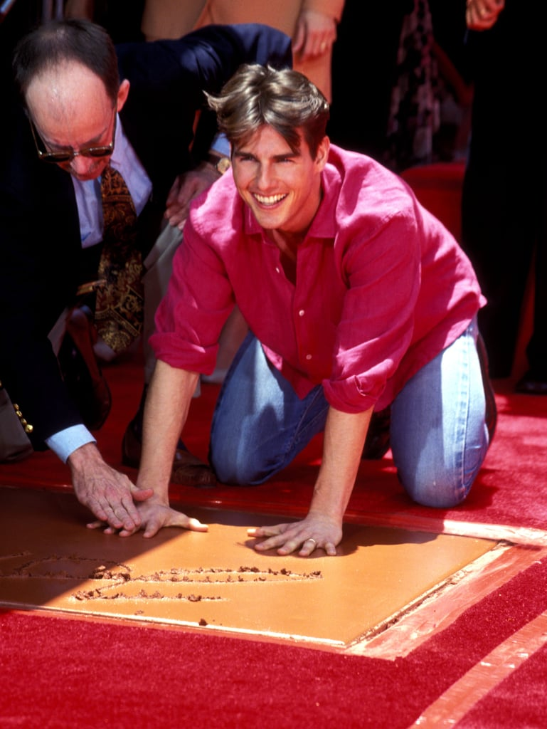 Tom Cruise smiled as he put his hands into the cement at Mann's Chinese Theatre in LA in June 1993.