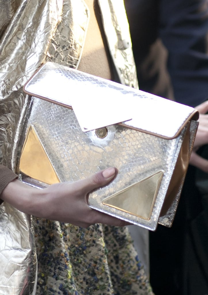 A textural gold clutch shined bright against an equally fetching metallic coat.