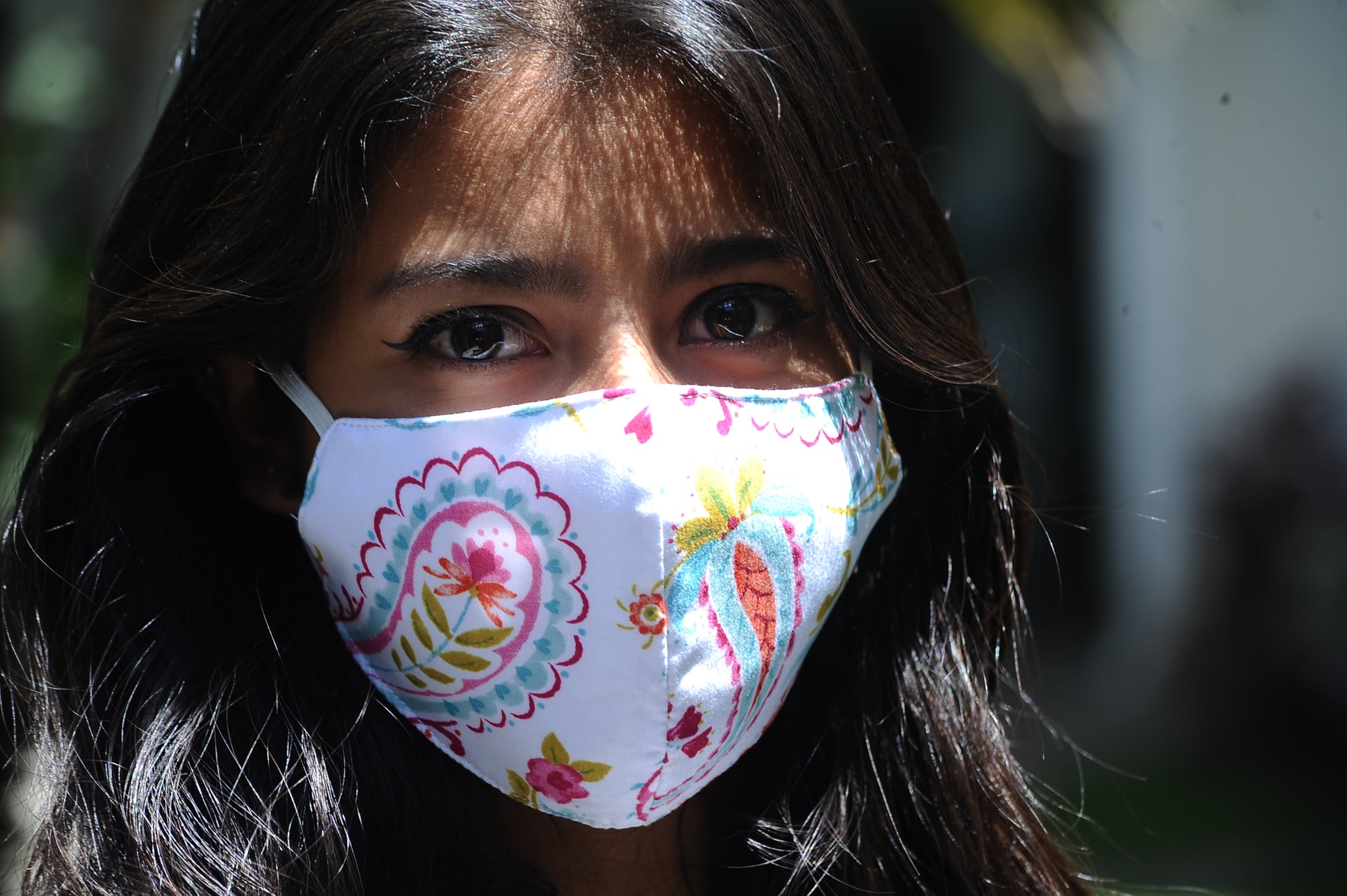 TLAXCALA, MEXICO - MAY 19, 2020: Maria de Lourdes Galindo, originally from Huamantla wears face mask while manufacturing a protective mask as an attempt to prevent Coronavirus desease , she worked in the clothing customization but due to coronavirus pandemic, has had to produce protective masks made by hand with typical fabrics from the region. On May 19, 2020 In Tlaxcala, Mexico- PHOTOGRAPH BY Fernando Camacho / Eyepix Group/ Barcroft Studios / Future Publishing (Photo credit should read Fernando Camacho / Eyepix Group/Barcroft Media via Getty Images)