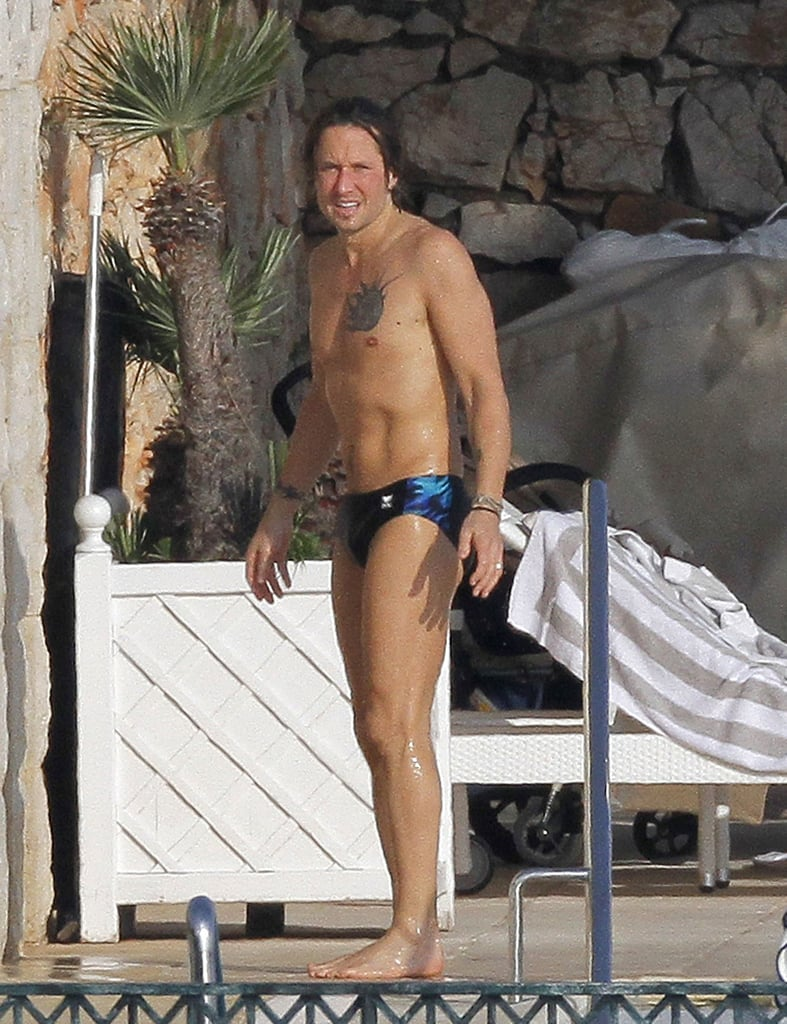 Keith Urban showed off his fit frame in a small swimsuit.