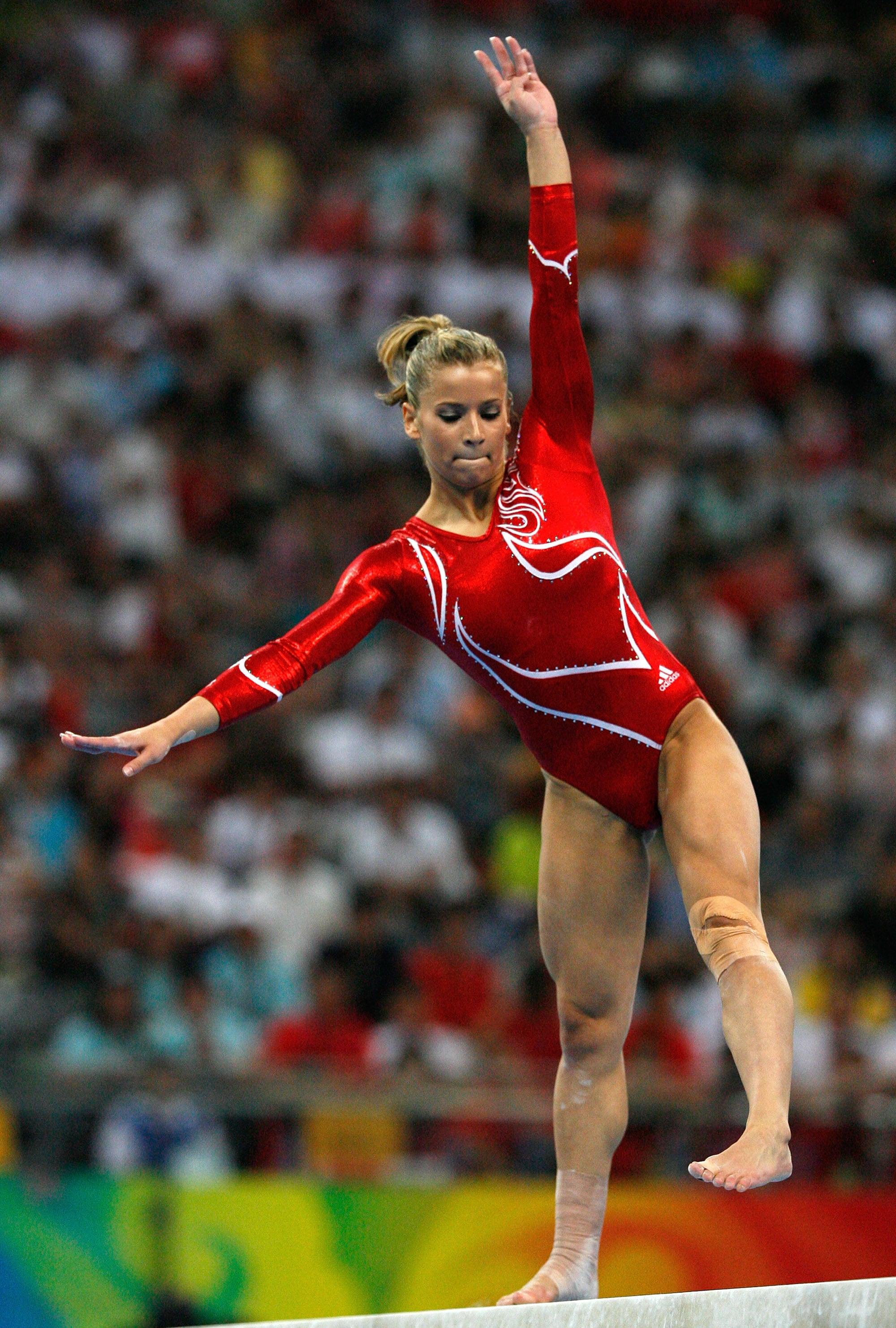 Alicia Sacramone loses her balance on the beam.