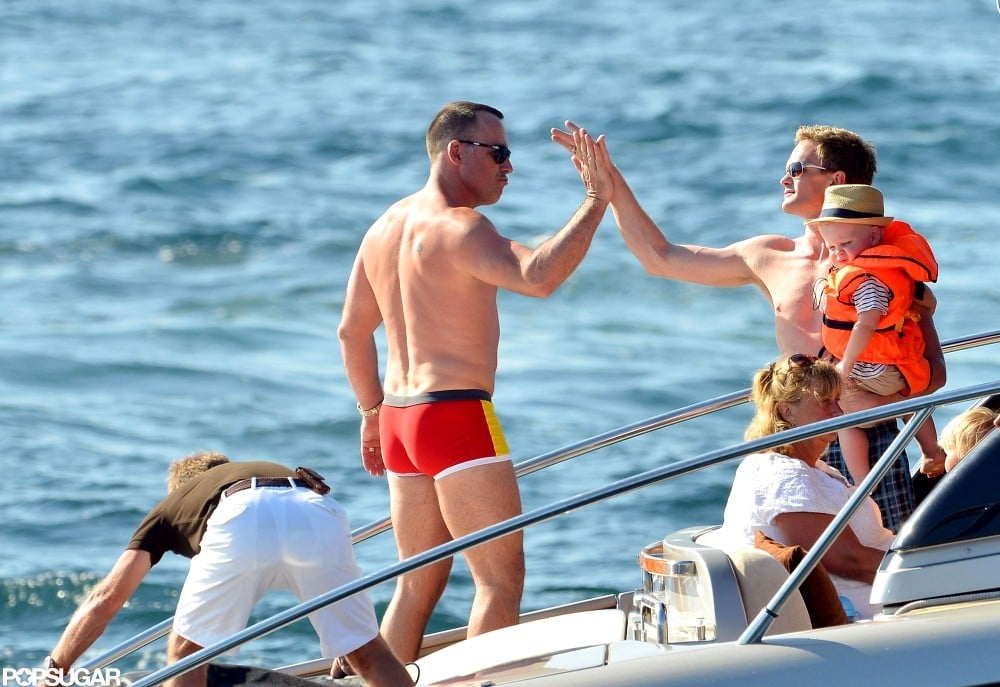 Neil Patrick Harris and David Furnish gave each other a high-five on the boat.