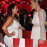 A pregnant Kim Kardashian caught up with Molly Sims at Elton John's Oscar party.
