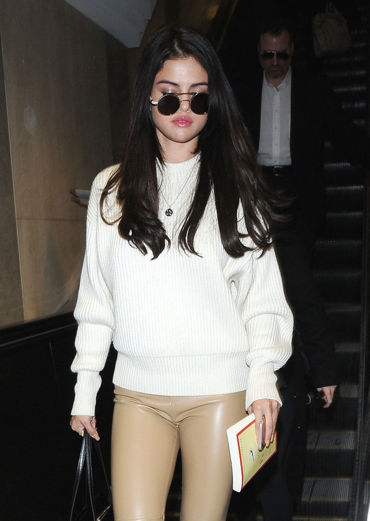 "Selena Gomez was spotted arriving at LAX airport on Monday afternoon. The ""Good For You"" singer kept things casual in an ivory sweater, tan leather leggings, and sunglasses and carried a book with her as she made her way past photographers. While Selena has been taking some time away from the spotlight to focus on her mental health, she recently stepped out at the American Music Awards, where she was honored with the favorite female artist award. During her speech, Selena got extra emotional as she thanked her fans for their support and even had a few words of encouragement for them, saying, ""If you are broken, you do not have to stay broken.""  Over the Thanksgiving holiday, Selena grabbed headlines once again after she returned to social media following a three-month hiatus to thank her Instagram followers. Along with a black and white concert photo, she wrote, ""I have a lot to be thankful for this year. . . . I have only wanted to reflect the love you guys have given me for years and show how important it is to take care of YOU.""      Related:                                                                                                           Even Celebrities Couldn't Deal With Selena Gomez's Emotional Return to the Spotlight at the AMAs"