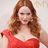 Zoom in on her gold earrings.