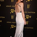 When she turned around, Emma revealed the sexy cutout back of her two-tone gown.