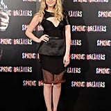 Ashley Benson opted for a darker look in an asymmetrical leather cutout top and a sheer peplum skirt, both by Izmaylova. She finished the look with black Casadei pumps.