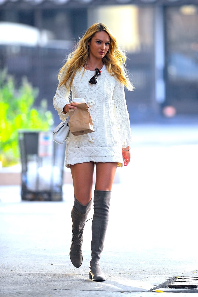 Candice Swanepoel wearing a Chanel bag and Stuart Weitzman ...