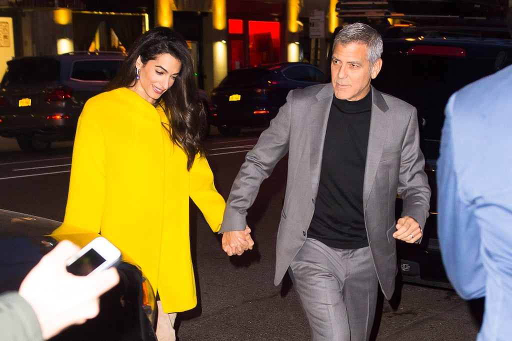 George and Amal Clooney are clearly enjoying NYC. The gorgeous couple — who welcomed twins Alexander and Ella in June 2017 — held hands as they made their way past paparazzi trying to catch a glimpse of the duo in SoHo on Friday night. George continued to prove that chivalry isn't dead when he held his arm out for his wife to hold while she walked down the steps in her beige knee-high boots and held her hand as they crossed the street. Their latest outing comes just a few weeks after they were spotted at the March For Our Lives rally in Washington DC. The pair also donated $500,000 to the movement which called for stronger gun control in the US. Keep reading to see more photos of their recent date night.      Related:                                                                                                           17 Times George and Amal Clooney Looked Madly in Love