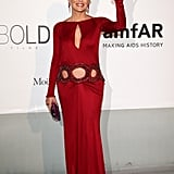 Sharon Stone wore a red gown with cutouts.