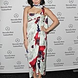 Vanessa Hudgens brought major glamour to Mercedes-Benz Fashion Week at Lincoln Center in a print wrap dress and silver metallic pumps.