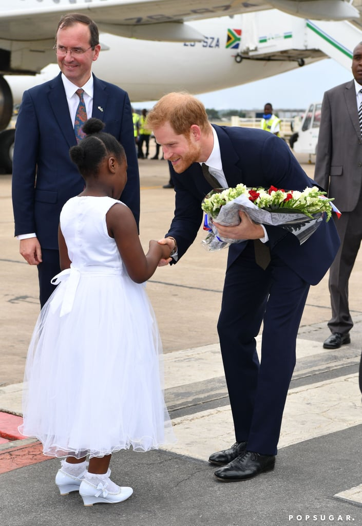 "Prince Harry has officially kicked off his solo trip to Zambia! On Monday, the Duke of Sussex received a warm welcome when a 9-year-old girl named Jane Chawanangwa greeted the royal with flowers at the airport in Lusaka. Following his arrival, Harry met with President Edgar Chagwa Lungu at State House and delivered a speech during a special reception to mark the start of his philanthropic visit. ""The goal is to create a platform not only where young people's voices are heard, but where they're supported in achieving their goals,"" Harry said. ""I'm excited to see some of that work in action tomorrow at Circus Zambia."" Over the next few days, Harry will attend events for the Queen's Commonwealth Trust, of which he is president, and will meet the winners of the Queen's Young Leaders Awards. He is also expected to meet with a number of organisations including conservation group African Parks (of which he is also president), BongoHive (Zambia's first technology and innovation hub), and Circus Zambia (an organisation that equips young people with life and academic skills).  Nov. 27 marks the anniversary of Harry and Meghan Markle's engagement announcement. Even though Harry and Meghan won't get to spend the day together, something tells us Meghan might be busy getting things ready for their upcoming move to Windsor Estate's Frogmore Cottage. Not to mention, they still have the arrival of their baby and their first wedding anniversary to look forward to."