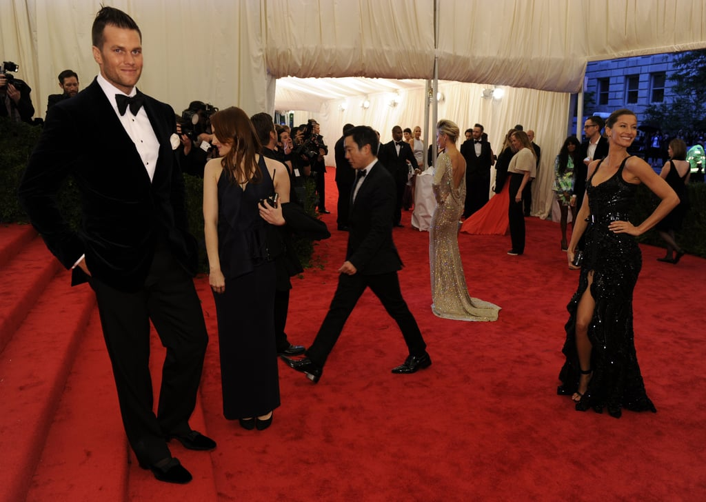 Tom Brady stepped aside to let Gisele Bundchen pose for the cameras. In the background, Cameron Diaz stopped for photographers as well.