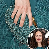 Going for a monochromatic look, actress Bérénice Bejo wore a teal polish that matched her lace dress and sparkling clutch.