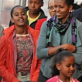 In June 2009, First Lady Michelle Obama toured the Eiffel Tower with daughters Malia and Sasha.