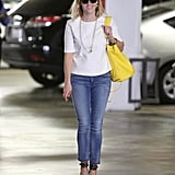 Reese's classic canvas — a white tee and skinny jeans — let her leopard ankle-strap sandals really shine.