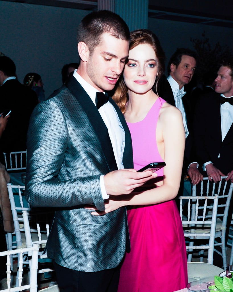 Andrew Garfield checked his phone while Emma Stone stuck close.