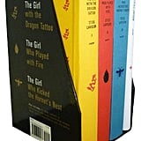 Stieg Larsson's Millennium Trilogy Deluxe Boxed Set: The Girl with the Dragon Tattoo, The Girl Who Played with Fire, The Girl Who Kicked the Hornet's Nest, Plus On Stieg Larsson ($50)